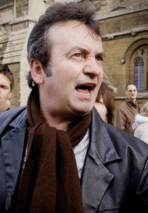 RIP: The late Gerry Conlon pictured outside the Houses of Parliament in 2000. He was there to witness the Blair apology for his and other wrongful imprisonments.