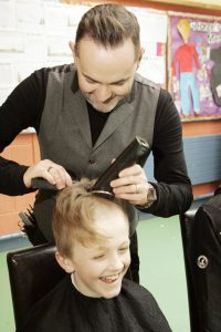 CLOSE SHAVE: Anthony Kilcoyne of Salon 2 Hair Studio gets stuck in to Matthew's mop of hair.
