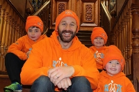 SUPPORT: Actor Chris O'Dowd wears orange with brothers Archie, George and Isaac Naughton.