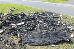 BLACKENED: The charred remains of the largest of three bonfires lit in Glencarrig Estate last week.