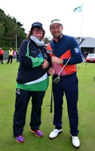 GOLF GREATS: Graeme McDowell shakes hands with Calry golfer Margaret Carr. Photo by Mark Runnacles/Getty Images.