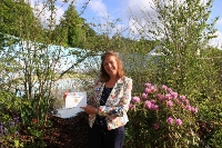 GOLD MEDAL: Garden designer Lorley Forrester pictured in her Yeats's Secret Garden in Sligo' holding up her Gold Medal certificate at Bloom 2015..   Picture by Nick Bradshaw