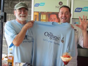 Hans Wieland presenting an Organic Centre t-shirt to chef Nevin Maguire, when he gave a cookery demonstration at the recent Organic Centre Garden Party.