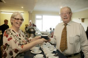 CUPPA: Brid Torrades of The Fairgreen in Skreen, serves her first cup of coffee to Joe Coulter at the official opening.