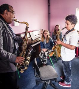 Grammy winning US saxophonist Ernie Watts gives some tips to young Sligo sax man Fraser Gaine, watched by Alice Purcell and Emily Gaine.