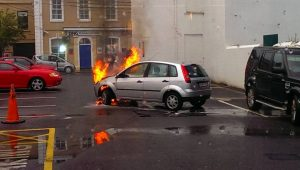 FIRE: This car burst into flames in the Dunnes Stores car park in Wine Street. An electrical or mechanical fault was believed to be the cause.