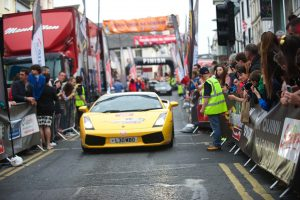 SLIGO WELCOME: A Lamborghini Diablo drives down O'Connell Street flanked by hundreds of spectators at last year's Cannonball Run.