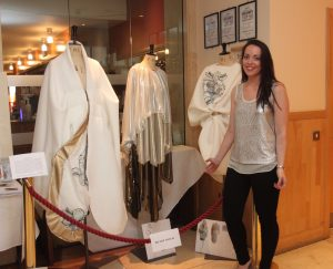 DESIGN: St Angela's student Emma Curtis stands next to her design work on display at the Yeats Nobel Dinner in June of this year at the Radisson Blu Hotel in Sligo.