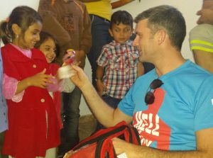 HOPE: Joy for a couple of young refugees on Kos as Sligo garda Ray Wims produces some toys he brought from home.