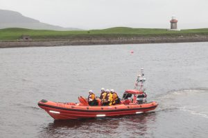 The new Atlantic 85 class lifeboat 'Sheila & Dennis Tongue' comes ashore after its maiden voyage on Tuesday.