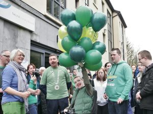 BALLOONS: Christopher Keenaghan prepares to release green balloons to mark Cerebral Palsy Awareness Day.