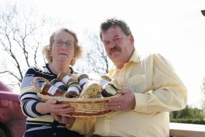 HOME PRODUCE: Courine and Ciaran Henderson with a hamper of their own homeproduced goods. Picture by Alan Finn