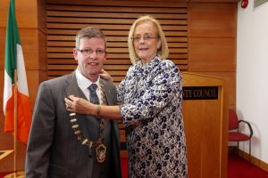 NEW TERM: Cllr Rosaleen O'Grady hands the chains of office over to Cllr Hubert Keaney.