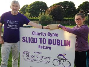 DONATION: 12 years-old Amy Hampson donating her birthday money to Con Lee for this weekend's fundraising cycle from Sligo to Dublin and back in aid of Sligo Cancer Support Centre.