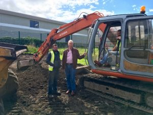 PROGRESS: Cllr Declan Bree visits workmen at the Fairgreen as the first phase of a recreational park on the site begins this week.