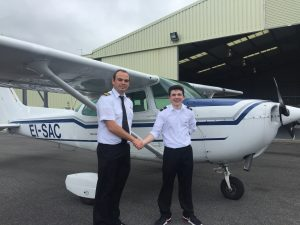 SOLO: Flying instructor Aaron Dineen congratulates teenager John Gerard Killeen on his first solo flight.